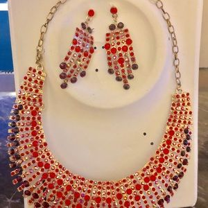 Red and gold tone necklace with matching earrings